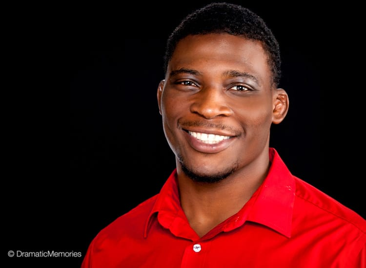 african american young man in a red shirt