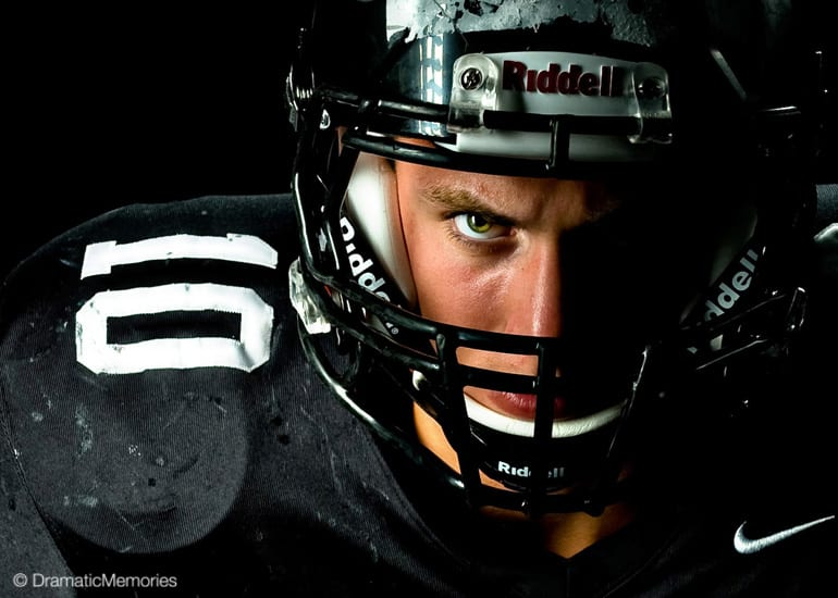 football player glaring through helmet