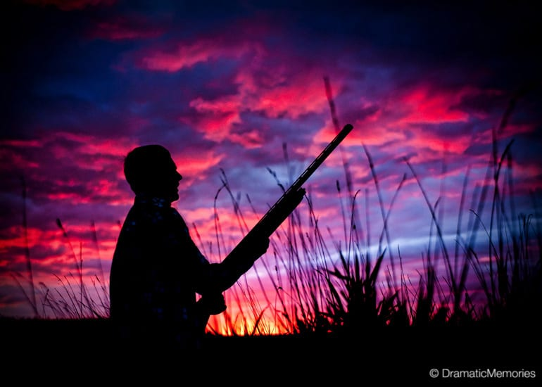 silhouette of a bird hunter at an amazing sunset