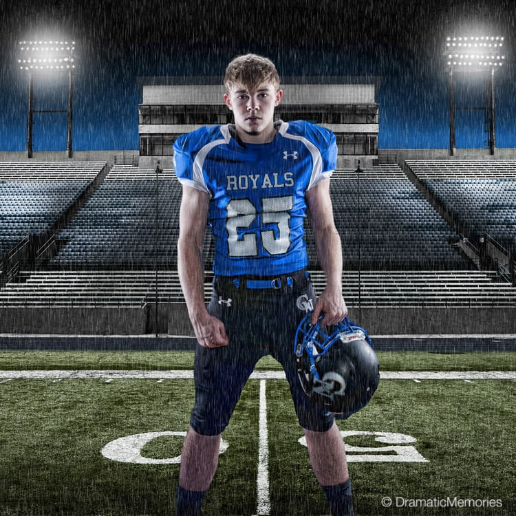 Sports Senior Pictures Football Player on Rainy Football Field
