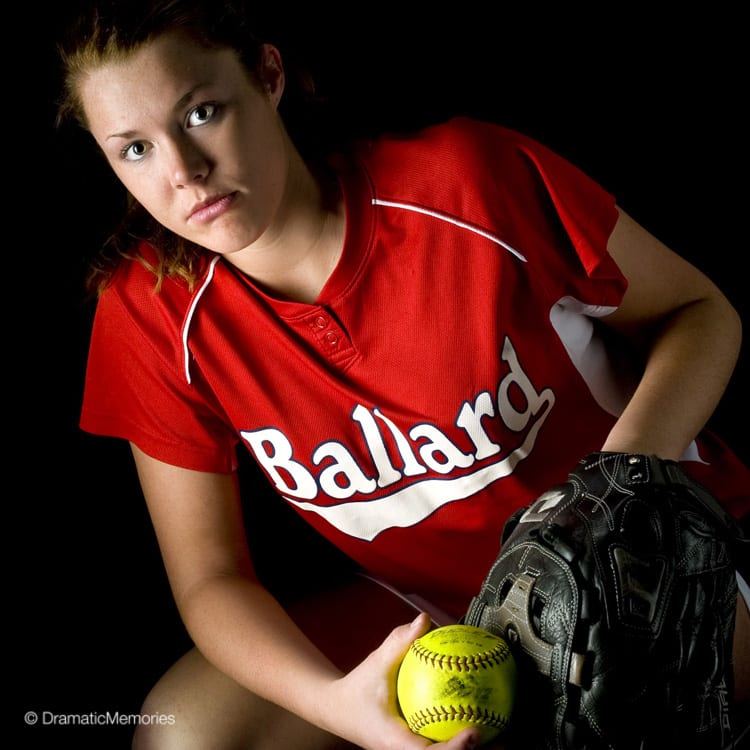 Sports Senior Pictures Girl Softball Pitcher with Dramatic Lighting