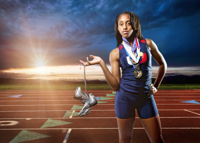 high school track champion with her medals around her neck