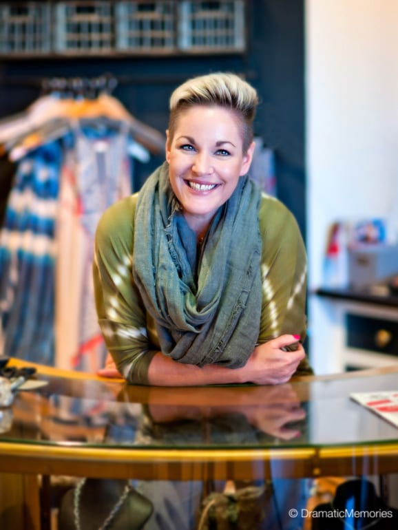 smiling business woman leaning on the front desk