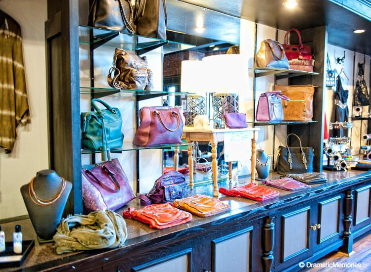 colorful purses displayed at a woman's clothing store